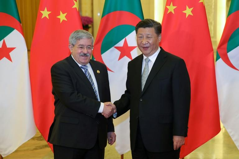 Chinese President Xi Jinping shakes hands with then Algerian prime minister Ahmed Ouyahia in Beijing in 2018