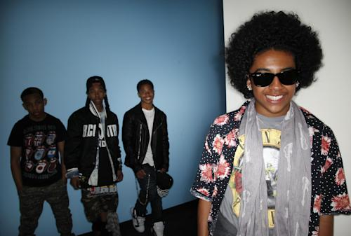 "CAPTION CORRECTION OF NAME: In this Tuesday, April 9, 2013 photo, members of teen R&B boy band, Mindless Behavior, Princeton, from right, Roc Royal, Ray Ray, and Prodigy pose for photos in Los Angeles. The group kicks off their ""All Around the World"" tour July 3, 2013, in Stockton, Calif. (AP Photo/Jae C. Hong)"