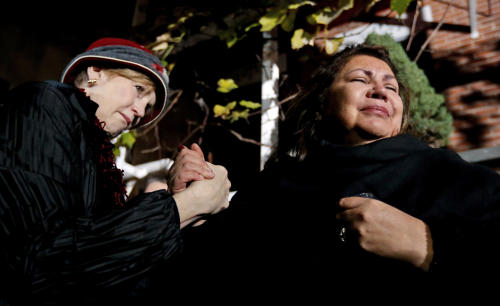 Margaret O'Connor, left, consoles Chef Priscila Satkoff during a candlelight memorial for Chicago chef Charlie Trotter outside Trotter's former restaurant Tuesday, Nov. 5, 2013, in Chicago. Trotter, 54, died Tuesday, a year after closing his namesake Chicago restaurant that was credited with putting his city at the vanguard of the food world and training dozens of the nation's top chefs, including Grant Achatz and Graham Elliot. (AP Photo/Charles Rex Arbogast)