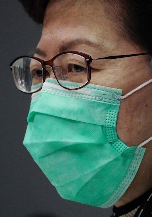 Chief Executive Carrie Lam wears a mask stamped with CSI. Photo: Robert Ng