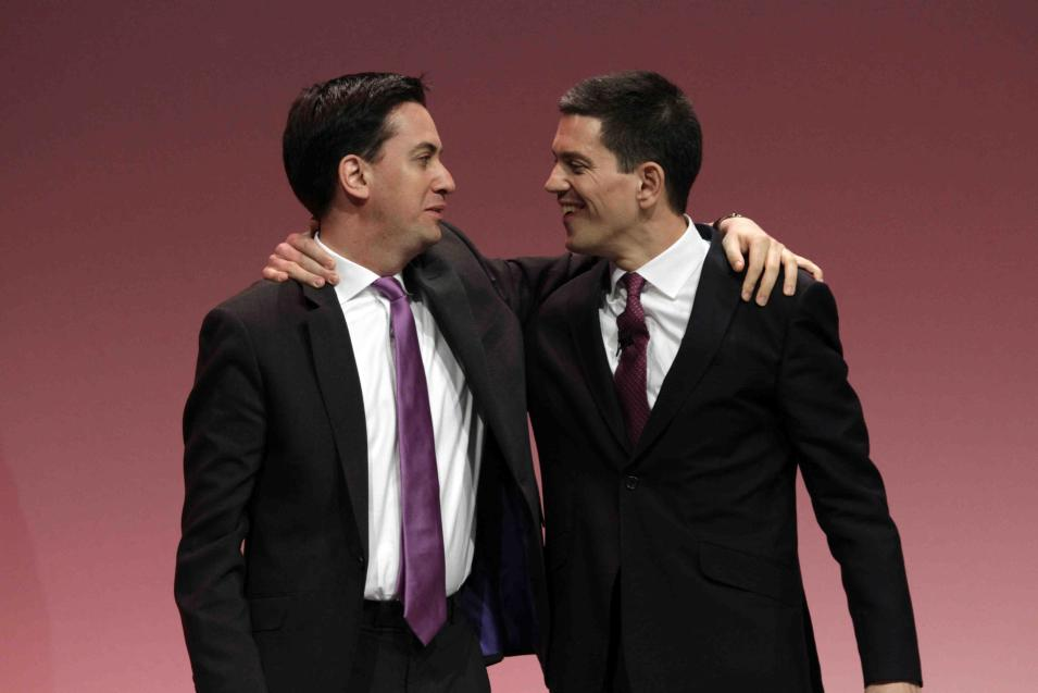 FILE - In this Monday, Sept. 27, 2010, file photo, Ed Miliband, left, newly-elected leader of Britain's opposition Labour Party, embraces his brother David Miliband, right, following David's speech on foreign policy during the party's annual conference, in Manchester, England.  Ed Miliband's Labour Party is in a virtual dead heat with Prime Minister David Cameron's Conservatives ahead of the vote on Thursday, May 7, 2015. (AP Photo/Lefteris Pitarakis, File)