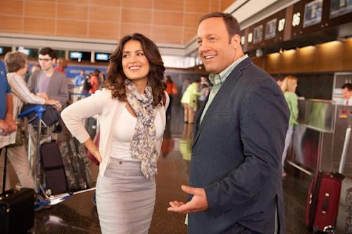 """This film image released by Columbia Picturers shows Salma Hayek, left, and Kevin James in a scene from """"Here Comes the Boom."""" (AP Photo/Columbia-Sony Pictures, Tracy Bennett)"""