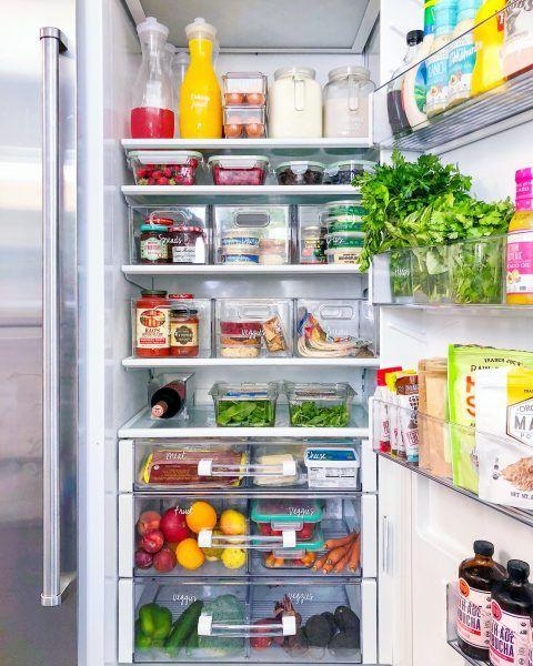 """<p>""""Divide your fridge into zones to match the categories you've created,"""" Shearer says. """"Make sure to leave a spot for beverages on the top shelf, as well as a section for leftovers.""""</p>"""