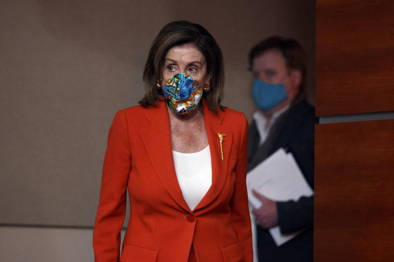 House Speaker Nancy Pelosi of Calif., wears a face mask as she arrives to speak at a news conference on Capitol Hill in Washington, Friday, June 26, 2020. (AP Photo/Carolyn Kaster)