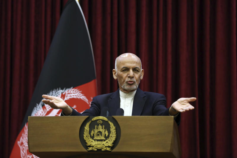 Afghan President Ashraf Ghani speaks during a news conference at the presidential palace in Kabul, Afghanistan, Sunday, March, 1, 2020. Ghani said Sunday he won't be releasing the 5,000 prisoners the Taliban say must be freed before intra-Afghan negotiations can begin. (AP Photo/Rahmat Gul)