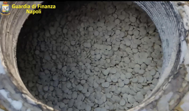 This image taken from a video shows amphetamines pills that were seized at the Salerno harbor, southern Italy, Wednesday, July 1, 2020.Italian police have seized 14 tons of amphetamines, allegedly produced in Syria by Islamic State group to fund terrorist activities and destined for the European illegal drug market. Customs Police Col. Domenico Napolitano on Wednesday called the discovery of three shipping containers crammed with some 85 million pills, in the southern port of Salerno, the biggest amphetamine seizure ever made worldwide. (Guardia di Finanza via AP)