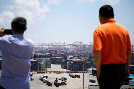 IMF berpihak pada pandangan yuan; mengatakan China bisa membutuhkan stimulus jika perang perdagangan memburuk