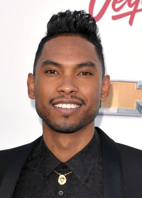 FILE - In this May 19, 2013 file photo, Miguel arrives at the Billboard Music Awards at the MGM Grand Garden Arena, in Las Vegas. The attorney for a woman whose head was hit after Miguel leaped into the crowd during the Billboard Music Awards in May said Thursday, June 13, 2013, that his client continues to suffer cognitive difficulties and has not received any assistance from the R&B singer or show producers. (Photo by John Shearer/Invision/AP, File)