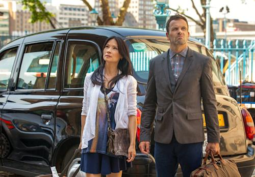 "In this undated image image released by CBS Entretainment on Thursday July 13, 2013 Jonny Lee Miller and Lucy Liu are photographed during filming season 2 of ""Elementary"" on the banks of the Thames in London. Sherlock Holmes is back on home turf in the second-season premiere of ""Elementary"" _ and so, a bit uncomfortably, is star Jonny Lee Miller.""It's a little bit surreal, to be honest with you,"" said the British actor, who plays a New York-based Sherlock in CBS' modern-day take on the great detective. (AP Photo/Joss Barratt /CBS Entertainment )"