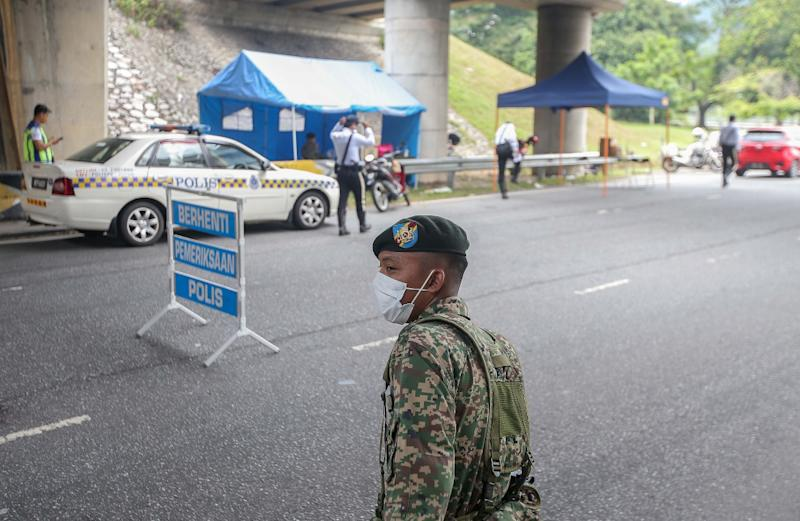 Both men had gone to a pond in Rimba Panjang in Sungai Siput on April 2 at 5pm and were stopped by policemen, who were patrolling. — Picture by Farhan Najib