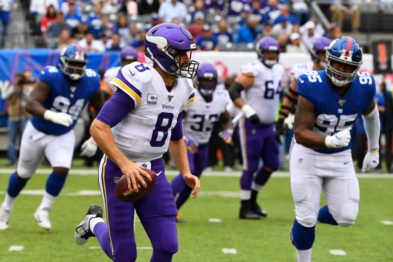 Kirk Cousins runs the ball against the Giants at MetLife Stadium. (Robert Deutsch-USA TODAY Sports)