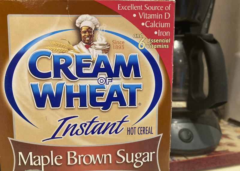 "A box of Cream of Wheat is displayed on a counter, Thursday, June 18, 2020 in White Plains, N.Y.  Cream of Wheat and Mrs. Butterworth are the latest brands reckoning with racially charged logos. B&G Foods Inc., which makes Cream of Wheat hot cereal, said it is initiating ""an immediate review"" of its packaging. A smiling black chef holding a bowl of cereal has appeared on Cream of Wheat packaging and in ads since at least 1918, according to the company's web site. (AP Photo/Donald King)"