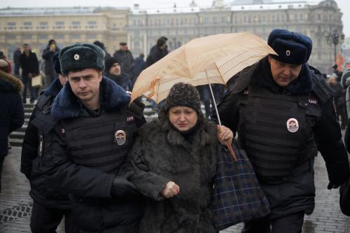 "FILE - In this Saturday, Feb. 8, 2014 file photo, police officers detain a protester near Red Square during an unauthorized protest in Moscow, Russia. Around 40 people gathered in downtown Moscow on Saturday to protest the decision of leading Russian cable and satellite companies to drop the channel, Dozhd (TV Rain). The independent television station Dozhd, or TV Rain, came under attack after asking viewers in January whether the Soviet Union should have surrendered Leningrad, now St. Petersburg, to save the lives of the 1 million people who died during the nearly 900-day Nazi siege of the city during the war. The station quickly pulled the poll and apologized, but President Vladimir Putin's spokesman said the station had crossed a ""red line."" Russian cable operators lined up to drop Dozhd from their packages and prosecutors opened an investigation. (AP Photo/Alexander Zemlianichenko, file)"