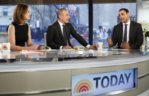 "This image released by NBC shows hosts Savannah Guthrie, left, and Matt Lauer, center, with news anchor A.J. Clemente on the ""Today"" show, Wednesday, April 24, 2013 in New York. Clemente was fired Monday after he opened his first-ever broadcast with obscenities on Sunday. (AP Photo/NBC, Peter Kramer)"