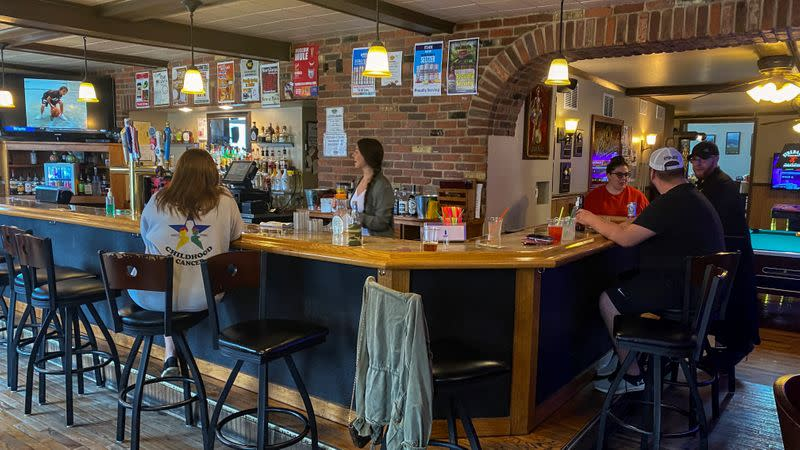 A handful of patrons mingle at Patio Bar and Grill