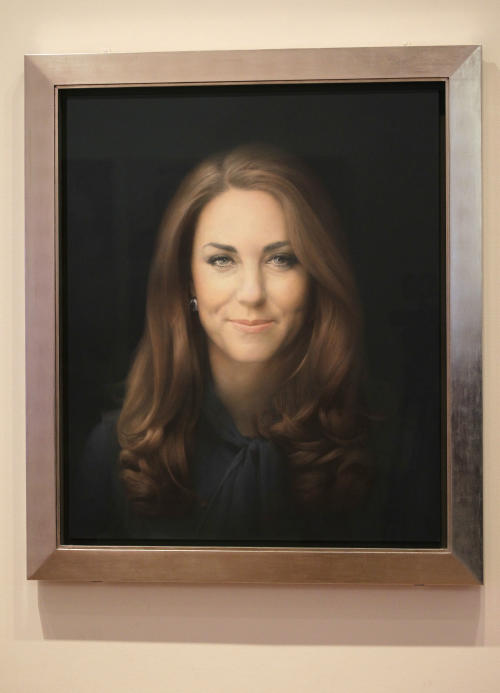 A newly-commissioned portrait of Kate, Duchess of Cambridge, by artist Paul Emsley hangs at the National Portrait Gallery in London, Friday, Jan. 11, 2013. (AP Photo/Sang Tan)