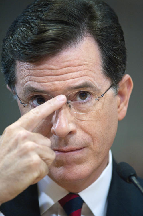 "Comedian Stephen Colbert testifies before the Federal Election Commission in Washington, Thursday, June 30, 2011. Colbert, who plays a conservative TV pundit on ""The Colbert Report,"" wants to launch Colbert Super PAC, a type of political action committee that would allow him to raise unlimited amounts of money from corporations, unions and individuals to support or oppose candidates in the 2012 elections through independent expenditures such as TV ads. (AP Photo/Cliff Owen)"
