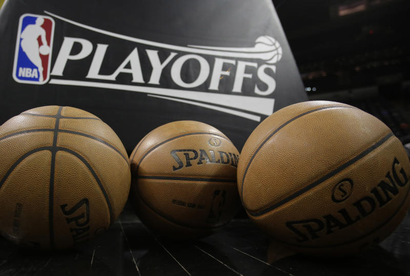 A logo for the NBA playoffs and official basketballs are seen on the court prior to Game 1 of an NBA basketball playoffs basketball game between the Los Angeles Lakers and San Antonio Spurs, Sunday, April 21, 2013, in San Antonio, Texas. (AP Photo/Eric Gay)