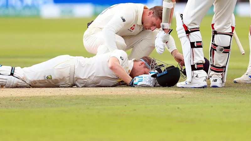 Jos Buttler, pictured here checking on Steve Smith. (Photo by Mike Egerton/PA Images via Getty Images)