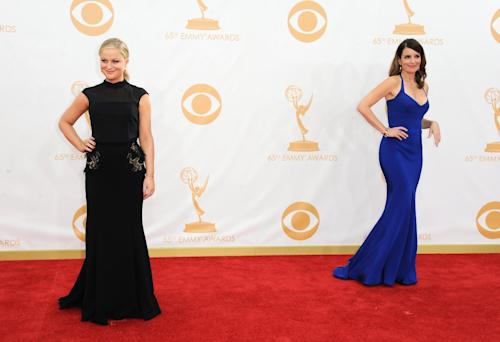 Amy Poehler, left, and Tina Fey arrive at the 65th Primetime Emmy Awards at Nokia Theatre on Sunday Sept. 22, 2013, in Los Angeles. (Photo by Jordan Strauss/Invision/AP)