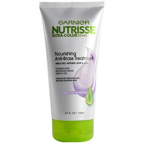 """<p><strong>Garnier</strong></p><p>amazon.com</p><p><strong>$7.97</strong></p><p><a href=""""https://www.amazon.com/dp/B07KJ4KPSJ?tag=syn-yahoo-20&ascsubtag=%5Bartid%7C10055.g.32837539%5Bsrc%7Cyahoo-us"""" target=""""_blank"""">Shop Now</a></p><p>Don't let the pricetag fool you — this budget-friendly double-duty Garnier toning treatment packs a big punch thanks to bonus conditioning benefits. """"I like that this<strong> gives hair cool toning and a deep treatment at the same time</strong> with nourishing botanical oils like black currant, olive, and avocado,"""" says GH Beauty Director <a href=""""https://www.goodhousekeeping.com/author/12308/april-franzino/"""" target=""""_blank"""">April Franzino</a>. This treatment can be used on both color-treated and natural blondes and (bonus!) smells amazing.</p>"""