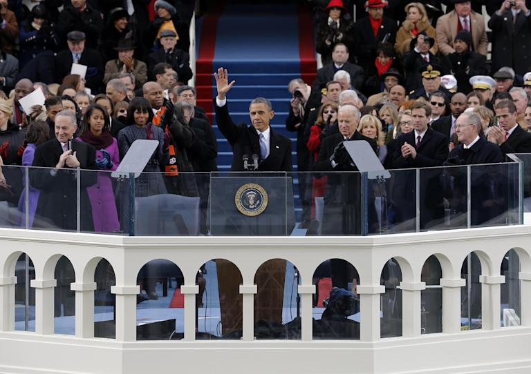 President Barack Obama waves to crowd after his Inaugural speech at the ceremonial swearing-in on the West Front of the U.S. Capitol during the 57th Presidential Inauguration in Washington, Monday, Jan. 21, 2013. (AP Photo/Scott Andrews, Pool)