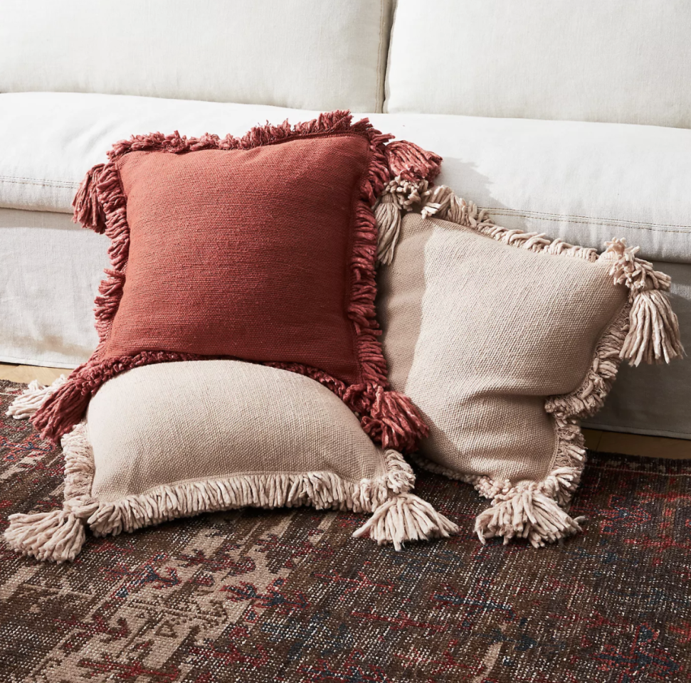 """<p><strong>Amber Lewis for Anthropologie Anthropologie</strong></p><p>anthropologie.com</p><p><strong>$78.00</strong></p><p><a href=""""https://go.redirectingat.com?id=74968X1596630&url=https%3A%2F%2Fwww.anthropologie.com%2Fshop%2Famber-lewis-for-anthropologie-fringed-joshua-pillow&sref=https%3A%2F%2Fwww.housebeautiful.com%2Fshopping%2Fg34130812%2Famber-lewis-anthropologie-collection%2F"""" target=""""_blank"""">Shop Now</a></p>"""