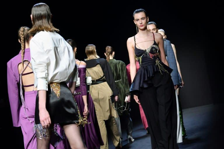 Models present creations for Chinese designer Han Wen