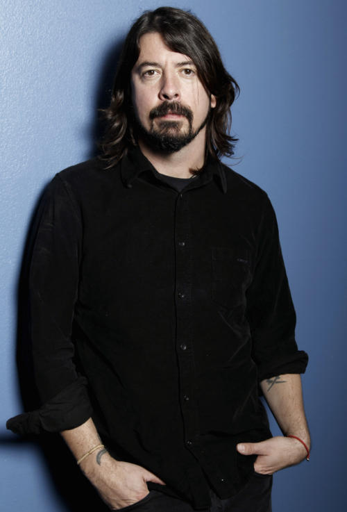"In this Jan. 31, 2012 photo, musician Dave Grohl poses for a portrait in Los Angeles. The 43-year-old Foo Fighters frontman's band had a top-selling tour, sold more than 663,000 copies of their album ""Wasting Light"" and were nominated for six Grammys, including album of the year. (AP Photo/Matt Sayles)"