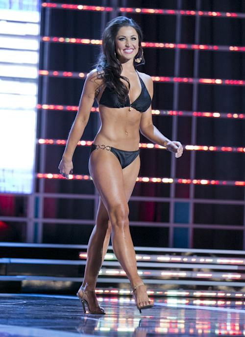 This photo courtesy Miss America Organization shows Miss Illinois Megan Ervin took the trophy for the second round of the Lifestyle and Fitness category Wednesday, Jan. 9, 2013, after modeling a Catalina swimsuit at the Miss America preliminary competition at the Planet Hollywood Resort & Casino in Las Vegas. The 23-year-old from Rushville, Ill., earned a $1,000 Amway scholarship for it. (AP Photo/Courtesy Miss America Organization)