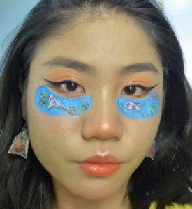 Lee paints a pair of koi ponds under her eyes, accompanied with matching earrings. Photo: Lee Ming Hui / Instagram