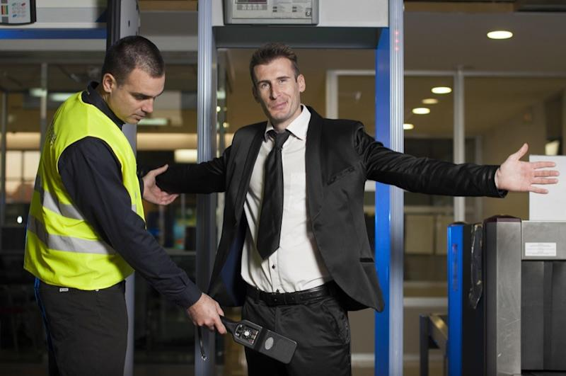 guy going through airport security