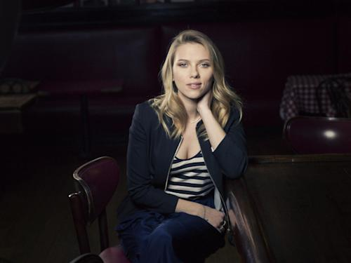"In this Tuesday, Nov. 27, 2012 photo, American actress, model and singer, Scarlett Johansson, currently starring in ""Cat on a Hot Tin Roof"" on Broadway, poses for a portrait, at Sardi's in New York. The actress with the pouty lips and gentle curves that GQ magazine once called ""Babe of the Year"" is determined to be a more naturalistic Maggie the Cat in a revival of Tennessee Williams' ""Cat on a Hot Tin Roof"" that opens Jan. 17, 2013. (Photo by Victoria Will/Invision/AP)"