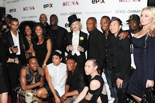 """Madonna poses with her dancers and backing musicians at the world premiere of """"Madonna: The MDNA Tour"""" at the Paris Theatre on Tuesday, June 18, 2013 in New York. (Photo by Evan Agostini/Invision/AP)"""