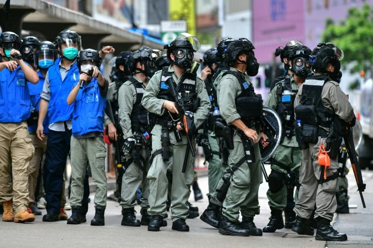 Riot police gather on a road in Hong Kong as protesters take part in a pro-democracy rally against China's proposed new security law in May 2020
