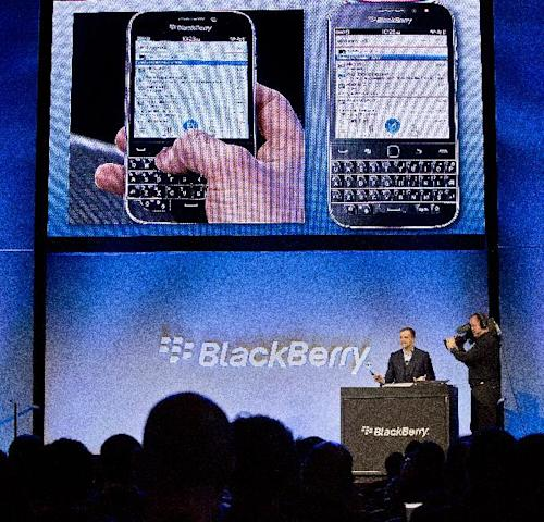 BlackBerry's director of marketing and enterprise Jeff Gadway demonstrates the company's new phone the BlackBerry Classic, during a news conference, Wednesday, Dec. 17, 2014, in New York. (AP Photo/Bebeto Matthews)