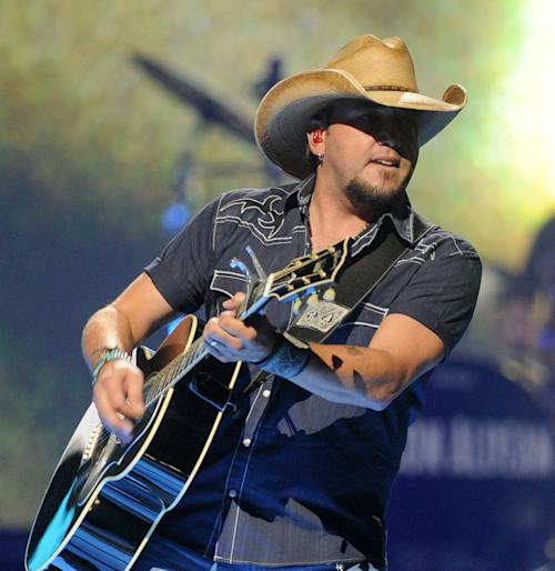 FILE - In this Sept. 21, 2012 file photo, Jason Aldean performs at the iHeart Radio Music Festival at the MGM Grand Arena in Las Vegas. Aldean is among the first round of performers announced for the American Country Awards, held Dec. 10, 2012 at the Mandalay Bay in Las Vegas. (Photo by Eric Reed/Invision/AP, File)