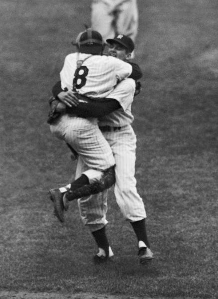 FILE - In this Oct. 8, 1956, file photo, New York Yankees catcher Yogi Berra leaps into the arms of pitcher Don Larsen after Larsen struck out the last Brooklyn Dodgers batter to complete his perfect game during Game 5 of the World Series in New York. Larsen, the journeyman pitcher who reached the heights of baseball glory in 1956 for the Yankees when he threw a perfect game and only no-hitter in World Series history, died Wednesday, Jan. 1, 2020. He was 90. (AP Photo/File)
