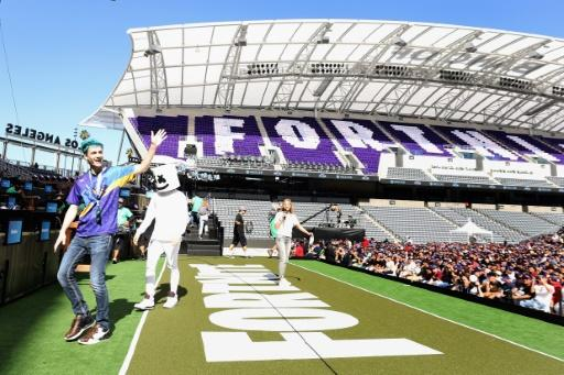 """Video game celebrities """"Ninja"""" and """"Marshmello"""" walk onstage during the Epic Games Fortnite E3 Tournament at the Banc of California Stadium"""