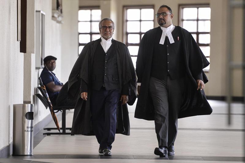 Datuk Seri Najib Razak's defence lawyers, Tan Sri Muhammad Shafee Abdullah and Harvinderjit Singh, are seen at the Kuala Lumpur Courts Complex June 20, 2019. — Picture by Miera Zulyana