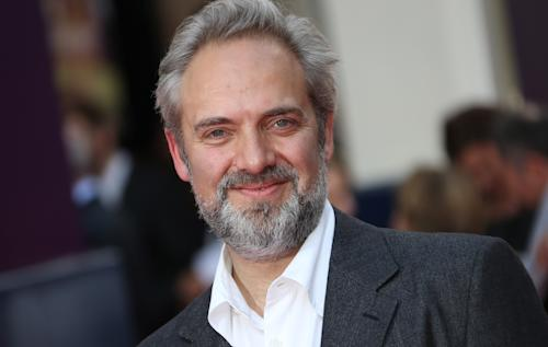 "FILE - In this June 25, 2013 file photo, director Sam Mendes arrives for the opening night of the musical ""Charlie and the Chocolate Factory,"" at the Drury Lane Theatre in central London. Mendes is coming back to direct another James Bond film with Daniel Craig following the enormously successful ""Skyfall."" Mendes had suggested ""Skyfall"" would be his lone entry in the 007 canon, but Bond producers and Sony Pictures announced his return Thursday, July 11. (Photo by Joel Ryan/Invision/AP, File)"