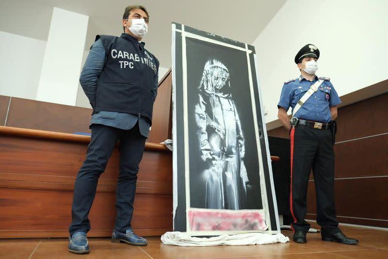 France arrests six over stolen Banksy artwork - source
