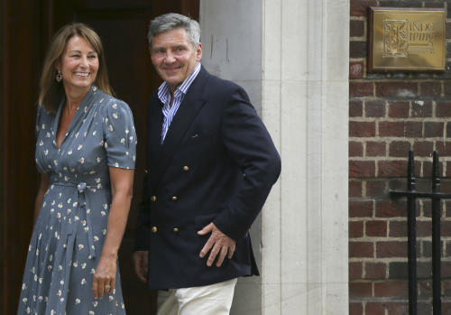 Carole and Michael Middleton, the parents of Kate, Duchess of Cambridge, smile as they arrive at St. Mary's Hospital exclusive Lindo Wing in London, Tuesday July 23, 2013 where the Duchess gave birth on Monday July 22. The Royal couple are expected to head to London's Kensington Palace from the hospital with their newly born son, the third in line to the British throne. (AP Photo/Alastair Grant)