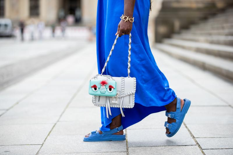 BERLIN, GERMANY - MAY 30: Lois Opoku is seen wearing blue dress Tibi, Chanel sandals, Fendi mini bag and Proenza Schouler bag on May 30, 2020 in Berlin, Germany. (Photo by Christian Vierig/Getty Images)