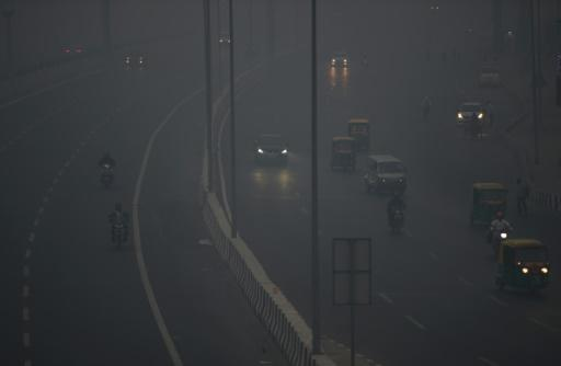 Commuters travel amid heavy smog in New Delhi after a night of free-for-all Diwali fireworks