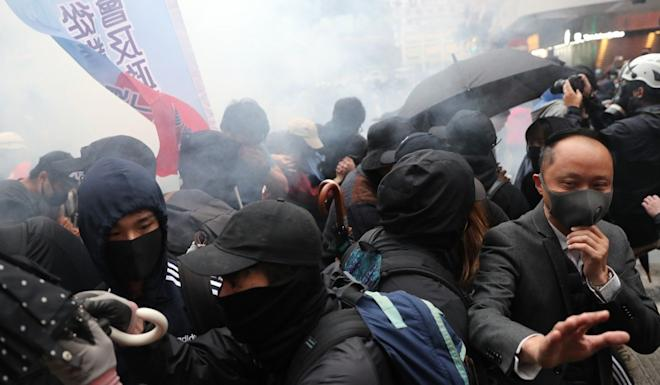 Police use tear gas on protesters during the New Year's Day demonstration. Photo: Sam Tsang