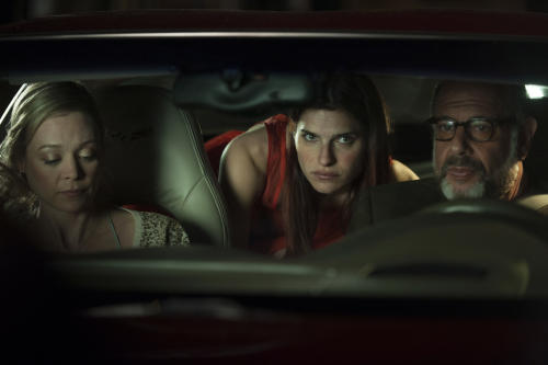 "This publicity photo released by Roadside Attractions shows, from left, Alexandra Holden, Lake Bell and Fred Melamed, in a scene from the film ""In a World...,"" a comedy about a struggling voice coach. Written and directed by Bell, who also stars in the film, it won the Sundance 2013 Waldo Salt Screenwriting Award for the script. Real voice-over artists, the men and women who've spent years invisibly announcing the latest Taco Bell temptation, the promise of Firestone tires or upcoming Lifetime programs, who've seen the film (which expands to more than 30 locations Aug. 16, 2013) say it's great to watch their profession on screen. (AP Photo/Roadside Attractions, Bonnie Osborne)"