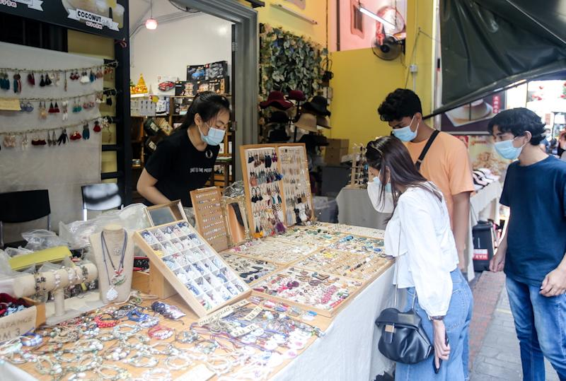 Loh Pui Wee, 18, a souvenir shopkeeper on Ipoh's Concubine Lane said that more local tourists are visiting the Ipoh Old Town area. — Picture by Farhan Najib