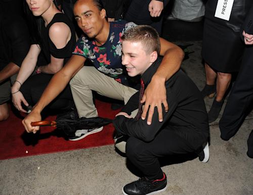 """Madonna's son Rocco Ritchie, right, attends the world premiere of """"Madonna: The MDNA Tour"""" hosted by The Cinema Society and Dolce & Gabbana at the Paris Theatre on Tuesday, June 18, 2013 in New York. (Photo by Evan Agostini/Invision/AP)"""