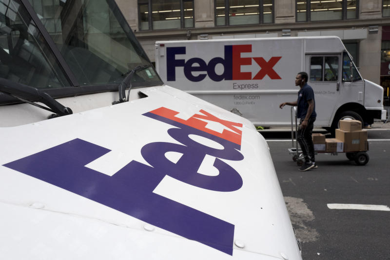 """FILE - This Aug. 22, 2017 file photo shows FedEx trucks parked in New York. Companies with ties to the National Rifle Association have been dealing with increasing public pressure since the Parkland, Florida massacre that killed 17 people earlier this month. FedEx is the latest company prompted to make a statement, saying it """"opposes assault rifles being in the hands of civilians"""" but strongly supports the right to own a firearm. The delivery service, which offers discounts to NRA members, said it is sticking with the organization. (AP Photo/Mark Lennihan, File)"""